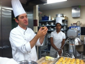 Chef showing us how to fill cream puffs.