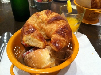 The bread basket that I was referring to. It typically has the croissant, but sometimes they run out and you're substituted with also scrumptious French bread.
